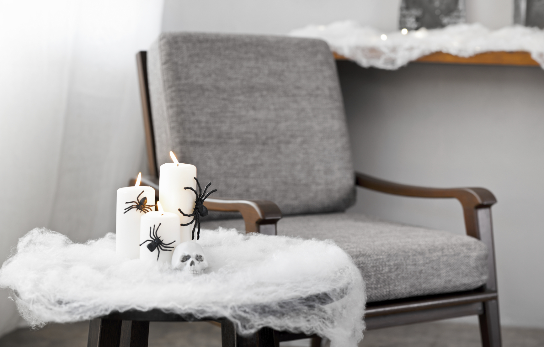 Grey upholstered chair in Halloween setting